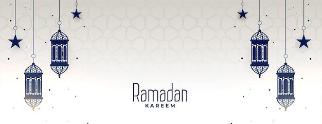 Banner kareem do ramadã com lâmpada e estrelas penduradas
