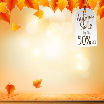 Banner promocional de venda de outono com folhagem de outono no fundo do bokeh