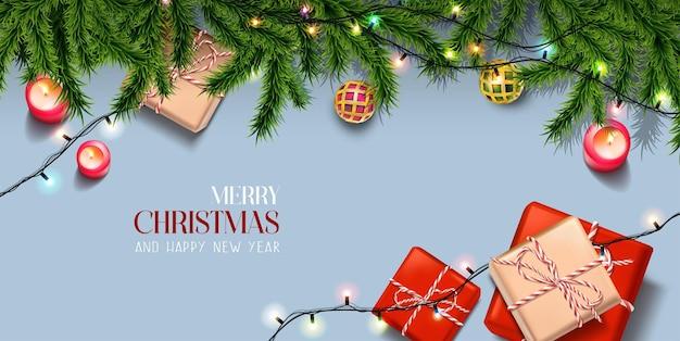 Banner realista feliz natal e feliz ano novo com elementos festivos orientação horizontal com três primeiros e caixas de presentes