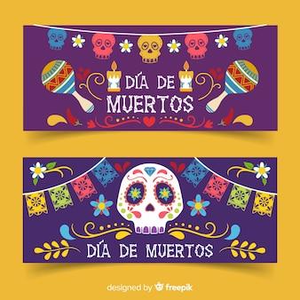 Banners de dia de muertos plana com maracas e caveiras