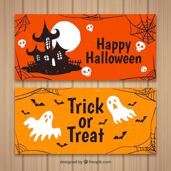Banners de halloween com casa e fantasmas