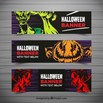 Banners de halloween com monstros desenhados à mão