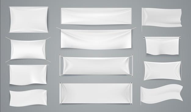 Banners de publicidade têxtil. sinais de tecido ondulado branco, em branco isolado