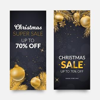 Banners de venda de natal dourado com bolas de natal e folhas de pinheiro