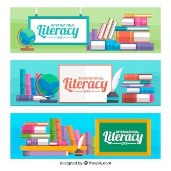 Banners do dia da alfabetização com livros e cartazes