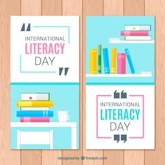 Banners do dia internacional da alfabetização com livros em design plano