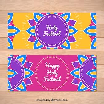 Banners festival de holi com mandalas coloridas no design plano