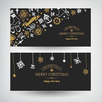 Banners horizontais de natal e ano novo com texto de saudação e símbolos tradicionais de natal no escuro