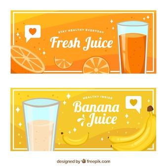 Banners planos com sumos de laranja e banana