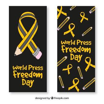 Banners pretos com lápis e fitas para o dia da liberdade de imprensa mundial