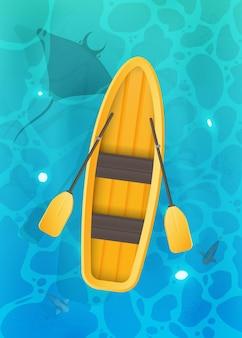 Barco amarelo com remos. superfície turquesa da água no oceano com peixes. vista de cima.