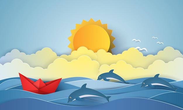 Barco de origami navegando e golfinhos nadando e sol forte em estilo de arte em papel
