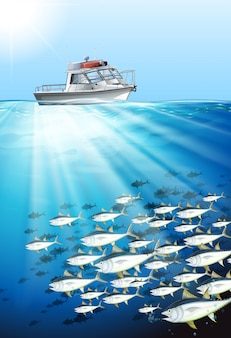 Barco de pesca e peixe sob o mar