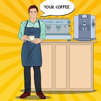 Barman bonito com uma xícara de café