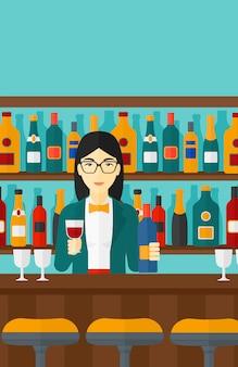 Barman em pé no balcão do bar
