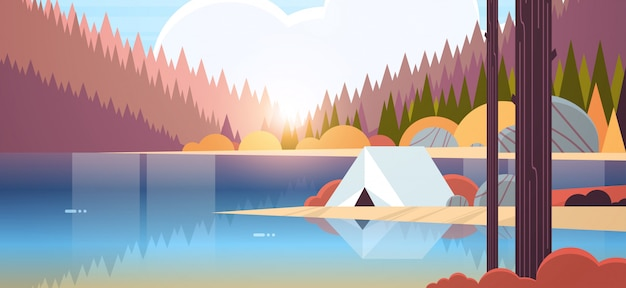 Barraca área de acampamento no acampamento da floresta perto do rio outono acampamento viagens férias conceito nascer do sol paisagem natureza com água montanhas e colinas