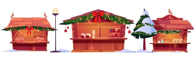 Barracas do mercado de natal, barracas de madeira de feiras de rua decoradas com galhos de pinheiros