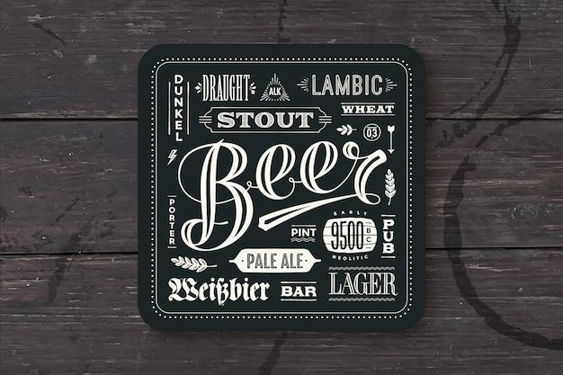Base para cerveja com letras de mão desenhada.