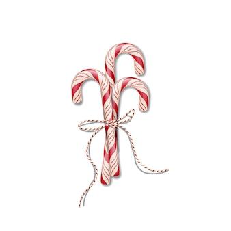 Bastões de doces de natal com fita vermelha.