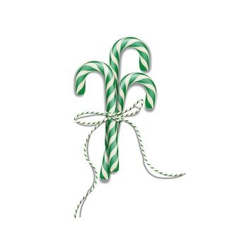 Bastões de doces de natal verdes com fita verde, elemento de design de natal ou ano novo.