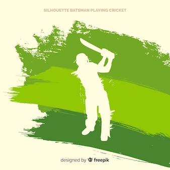 Batedor de silhueta jogando críquete