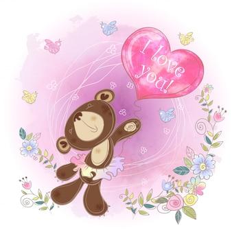 Bear bailarina com um balão em forma de um coração. namorados.