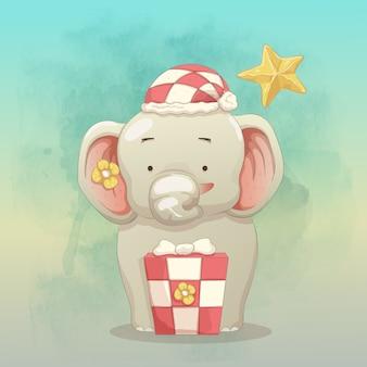 Bebê elefante feliz em receber presente de natal