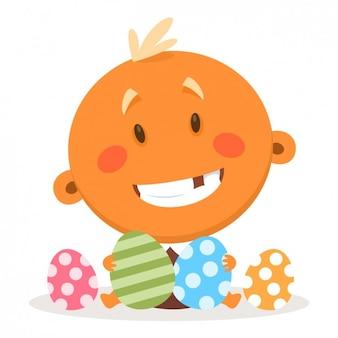 Bebê feliz com os ovos de páscoa