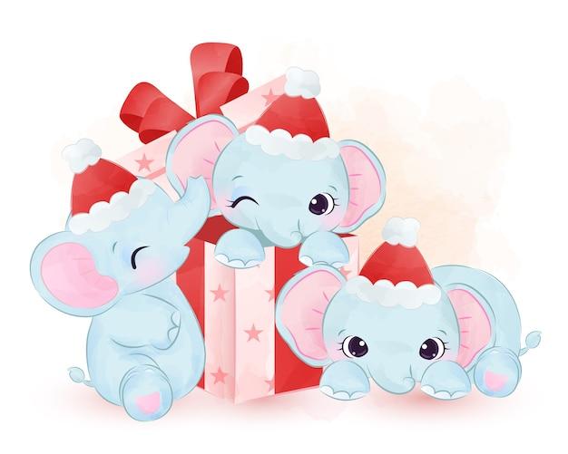 Bebês elefantes brincando com uma caixa de presente