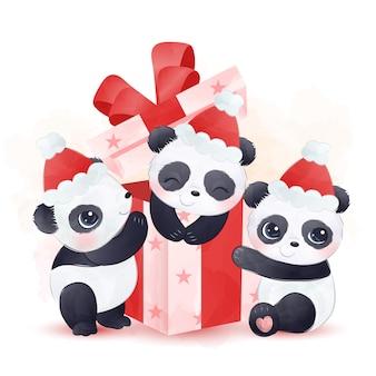 Bebês lindos pandas brincando com uma caixa de presente