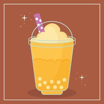 Bebida asiática taiwanesa com uma cor amarela e bolhas em um fundo marrom