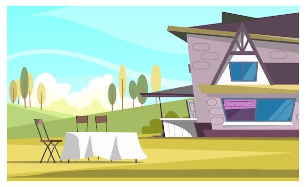 Bela casa e mesa redonda com pano ao ar livre