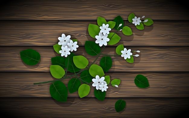 Bela flor de jasmim na placa de madeira