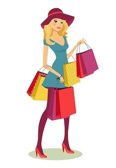 Bela jovem loira depois de fazer compras com muitas sacolas de compras nas mãos.