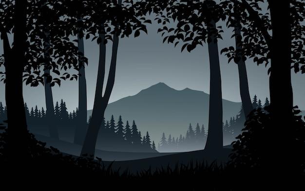 Bela paisagem de silhueta de floresta com montanha