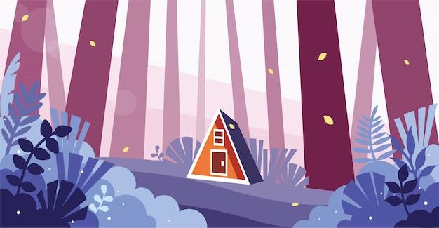 Bela vista de uma pequena casa na floresta