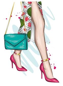 Belas pernas femininas e sapatos elegantes de salto alto