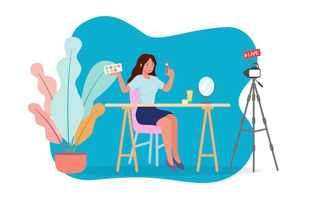 Beleza blogger teste escova de sombra para os olhos na frente da câmera, gravação de vídeo tutorial de maquiagem, streaming ao vivo em casa.