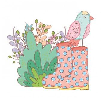 Belo pássaro com botas de jardinagem