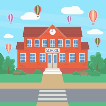 Bem-vindo ao prédio da escola tendo como pano de fundo arbustos verdes e um balão de ar quente