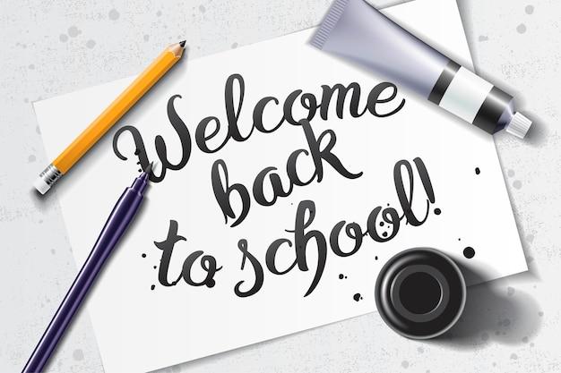 Bem-vindo de volta à escola letras feitas à mão com maquete de caligrafia com pincel