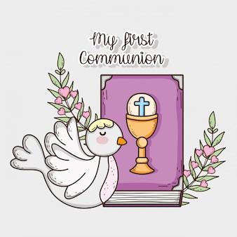 Bíblia com chaliz e host com pomba e galhos de folhas