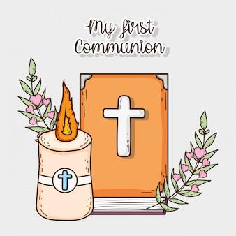 Bíblia com vela e cruz para a primeira comunhão