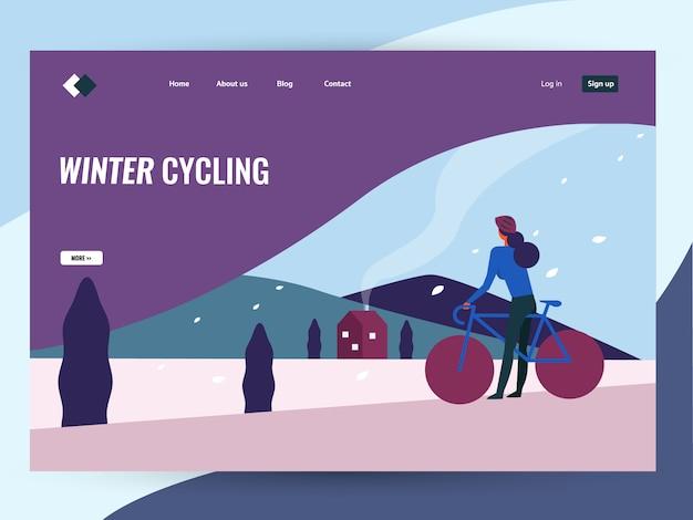 Bicicleta da equitação da mulher na paisagem do campo do inverno.