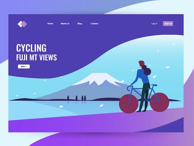 Bicicleta da equitação da mulher no inverno com paisagem de fuji mt.