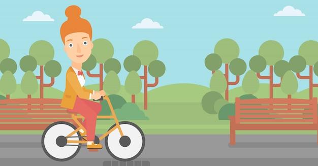 Bicicleta de equitação de mulher.