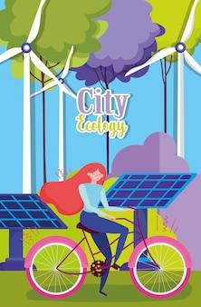 Bicicleta de equitação mulher com turbinas eólicas e painéis solares