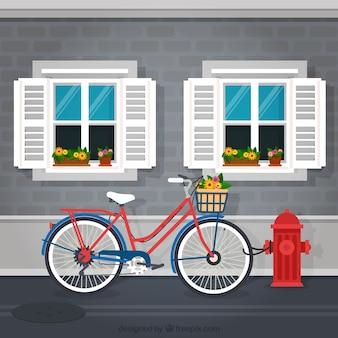 Bicicleta na frente de um fundo de fachada