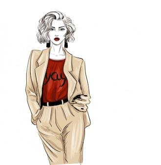 Biege terno moda mulher olha esboço de moda