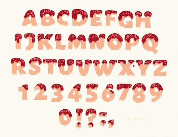 Biscoito com creme mão desenhada fonte decorativa. letras e números doces bonitos de abc.